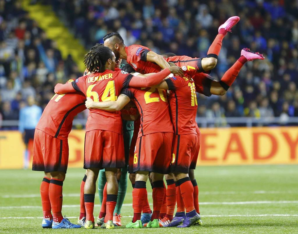 Galatasaray's players celebrate goal scored by Kisa during their Champions League group C soccer match against Astana at Astana Arena stadium in Astana