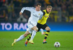 DORTMUND, GERMANY - APRIL 08:  Gareth Bale of Real Madrid takes on Oliver Kirch of Borussia Dortmund during the UEFA Champions League Quarter Final second leg match between Borussia Dortmund and Real Madrid at Signal Iduna Park on April 8, 2014 in Dortmund, Germany.  (Photo by Dennis Grombkowski/Bongarts/Getty Images)