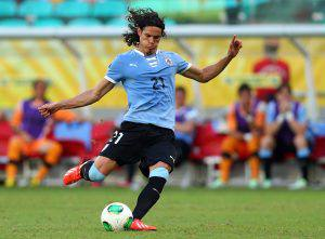 SALVADOR, BRAZIL - JUNE 30: Edinson Cavani of Uruguay scores his team's second goal to make the score 2-2 during the FIFA Confederations Cup Brazil 2013 3rd Place match between Uruguay and Italy at Estadio Octavio Mangabeira (Arena Fonte Nova Salvador) on June 30, 2013 in Salvador, Brazil. (Photo by Clive Mason/Getty Images)