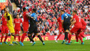 LIVERPOOL, ENGLAND - AUGUST 17: Tommy Elphick of Bournemouth (5) heads the ball past goalkeeper Simon Mignolet of Liverpool, but the goal is disallowed during the Barclays Premier League match between Liverpool and A.F.C. Bournemouth at Anfield on August 17, 2015 in Liverpool, United Kingdom. (Photo by Alex Livesey/Getty Images)